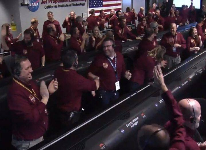 Screengrab of the NASA In Sight team celebrating touchdown at mission control