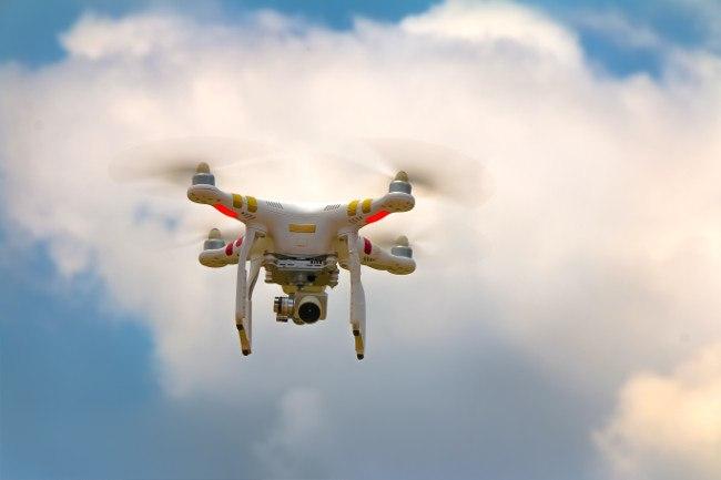drone flying in a cloud sky.