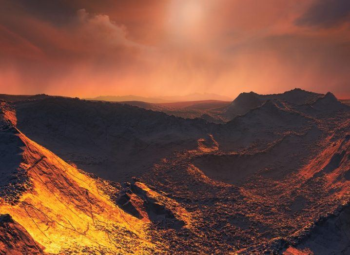 Artist's impression of the planet's surface with a rocky yellow and orange surface and dark orange sky.