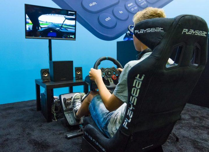 Gamer playing in a Logitech gamer chair.