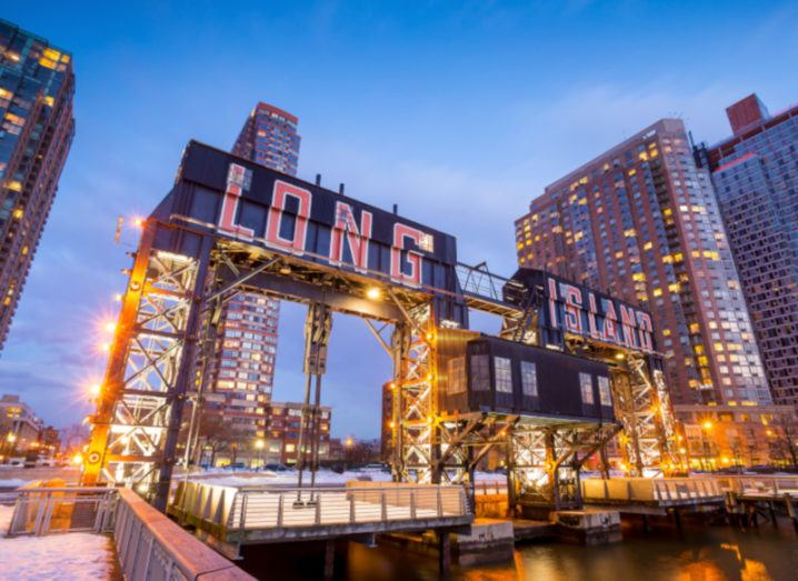 the buildings of long island in front of east river at twilight.