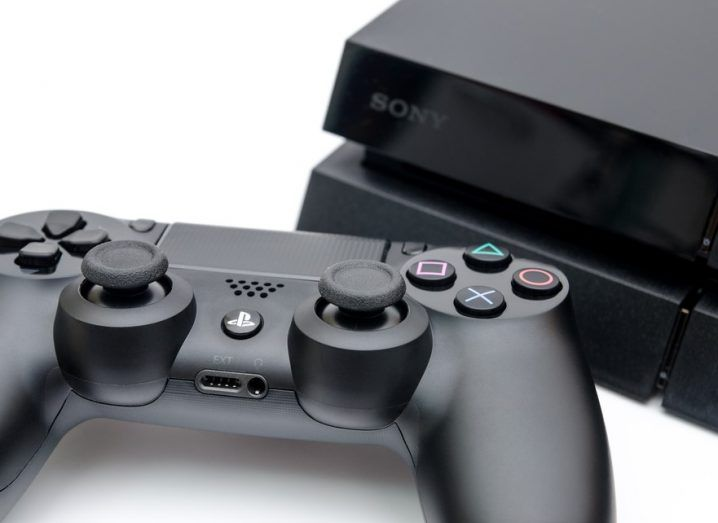 Sony Playstation 4 with Dualshock controller in a close view of the buttons and joysticks suggesting high tech modern gaming console and technology.