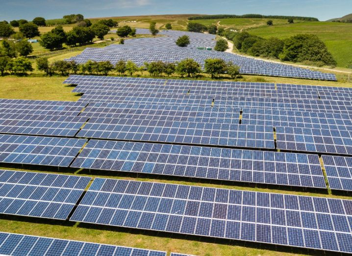 Picture of a field of solar panels in south Wales, UK.