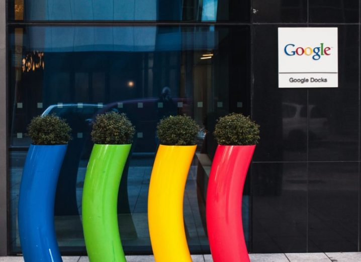 Four plastic plant containers in blue, green, yellow and red outside a Google office in Dublin.