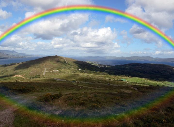 the view from a hillside on Bere island county Cork Ireland on a wet day with rainbow in background.
