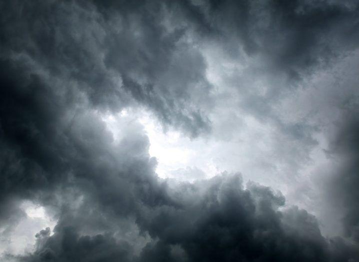 Sun peering through a dark, stormy cloud.