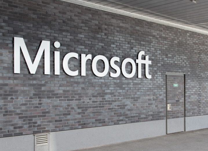 A grey interior wall bearing the Microsoft logo in metal letters.