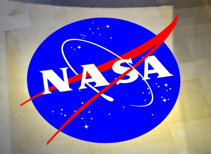 The NASA logo, a blue circle with white writing and inlaid stars.