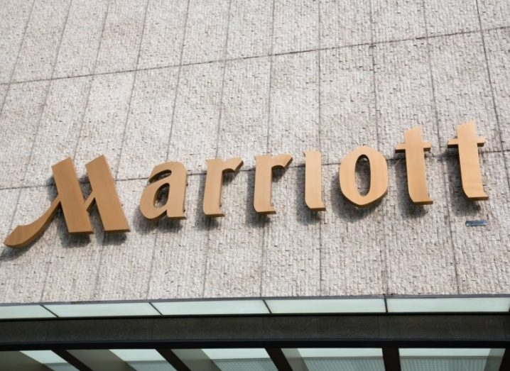 The Marriott hotel logo on an exterior wall of a hotel. Large brass letters.