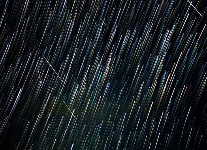 Long exposure streaks left by the Geminids meteor shower in the night sky.