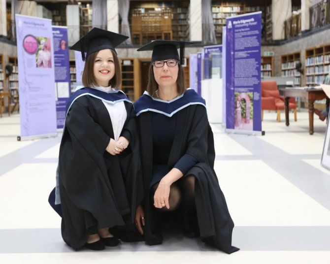 Sinéad Burke and Ann O'Dea dressed in caps and gowns at IADT's conferring ceremony.