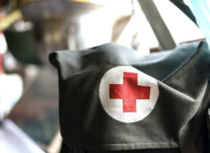 Medical red cross bag in military drab.