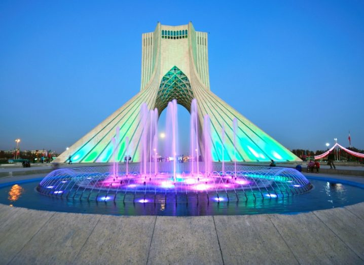 Azadi tower in Tehran,Iran, lit colourfully.