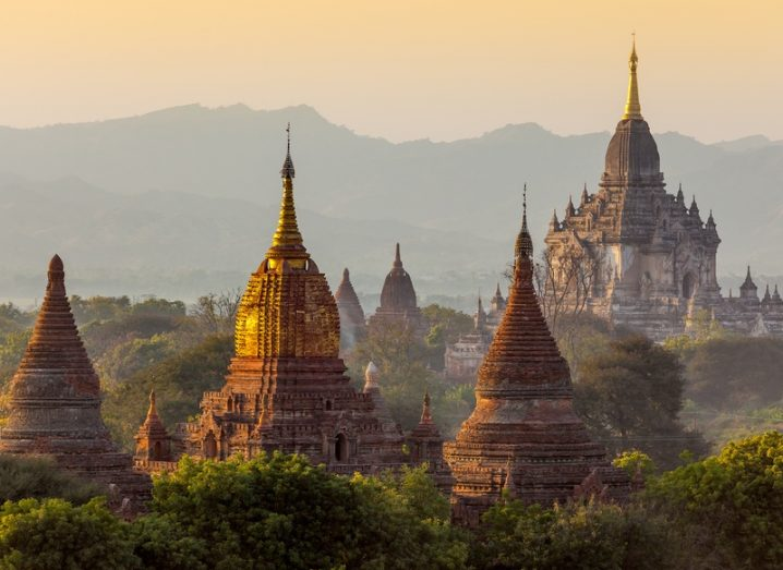 Buddhist temples in the Bagan area of Myanmar at sunrise.