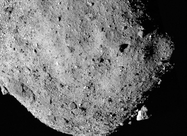 Close-up of the southern pole of the asteroid Bennu against a black background.