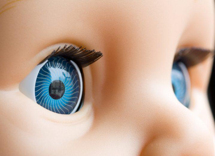 close-up of bright blue doll eyes with dark lashes.