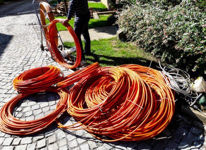 Orange fibre cable as part of a network construction.
