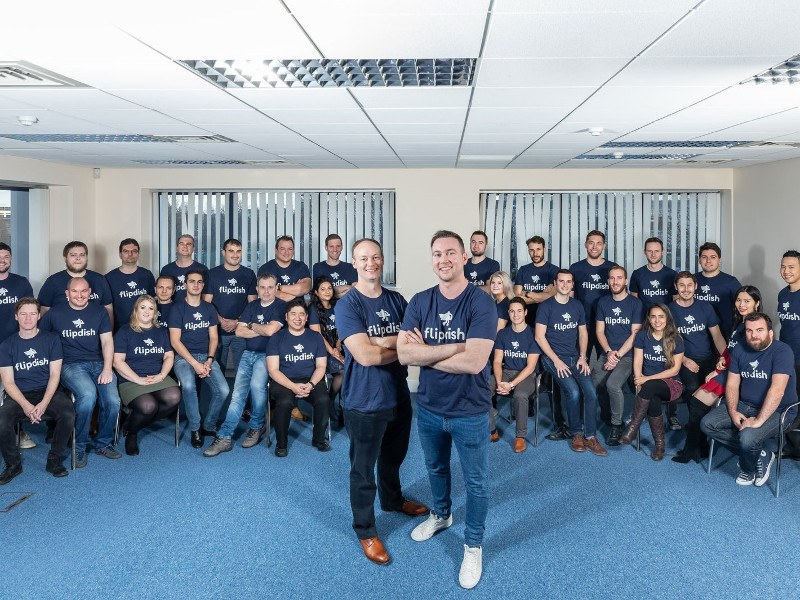 Group of people in blue t-shirts.