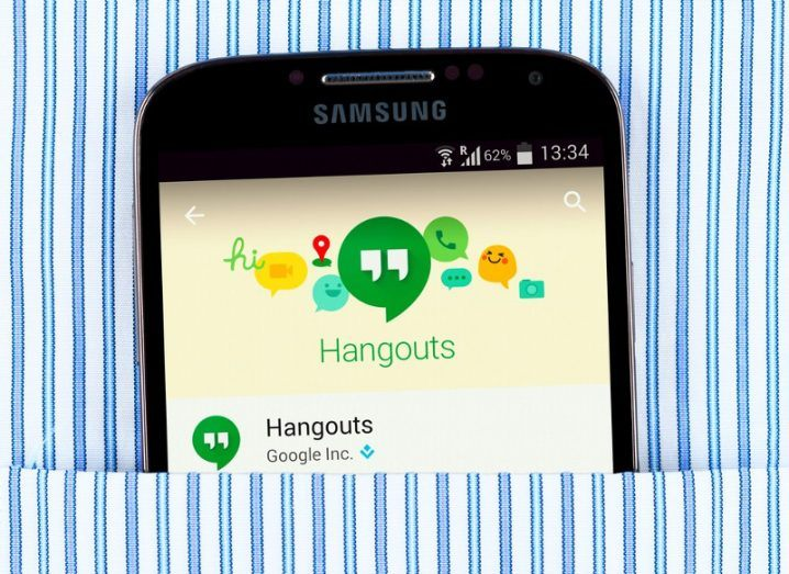 google hangouts app on a the screen of a Samsung phone in a stripey shirt pocket.