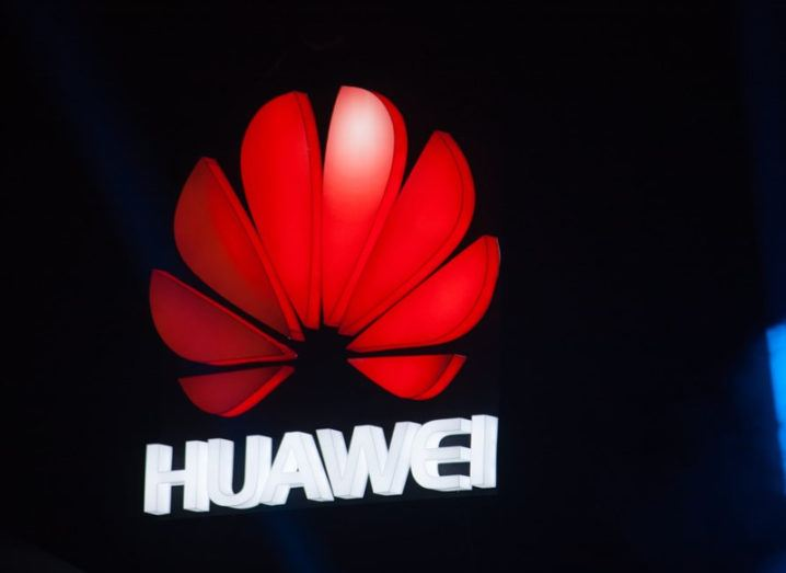 The logo of Huawei company above a stage.