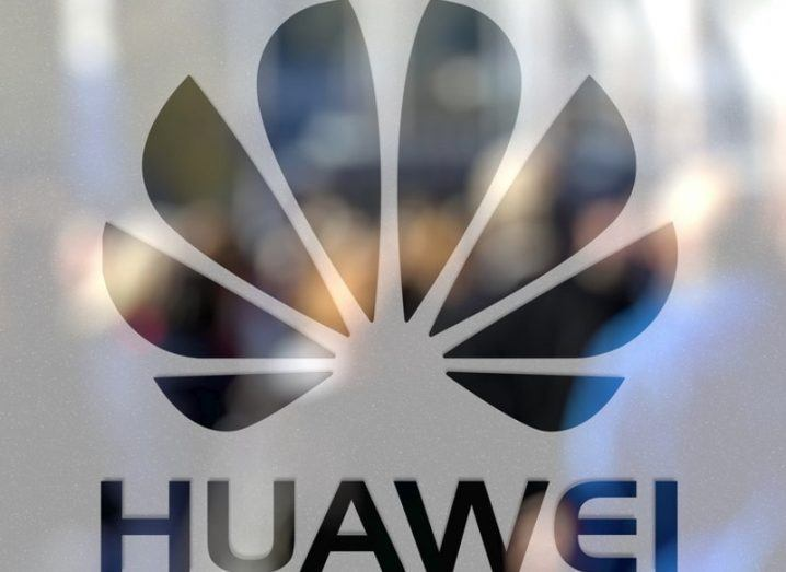 Huawei logo on frosted glass door.