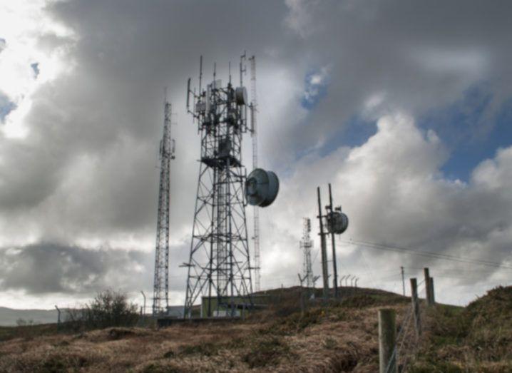 Radio mast on hillside on a stormy day.