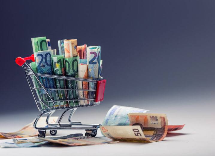 Shopping trolley full of euro money banknotes.