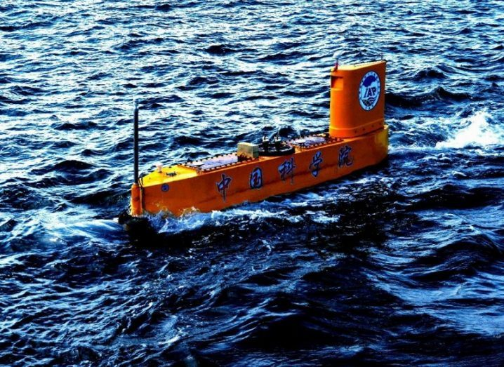 Shot of the long, narrow orange semi-submersible travelling in the Yellow Sea.