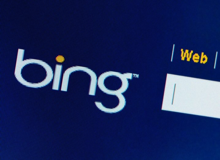 Bing logo on a computer monitor with search bar beside it.