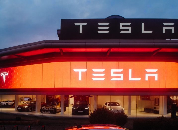 Tesla Motors showroom in London with red neon lighting on the exterior.