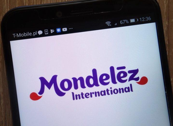 Mondelēz logo on a mobile device. A purple, chunky font.