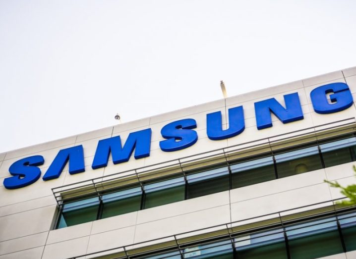 A building featuring the Samsung logo in blue with a grey sky in the background.