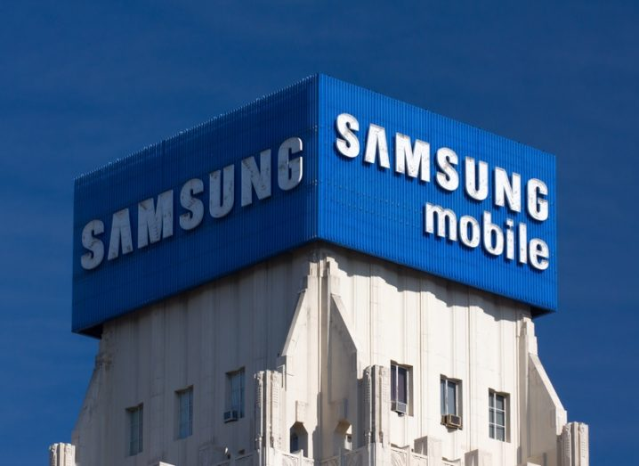 Samsung advertisement and logo on top of a tower block in Los Angeles, with a blue sky.