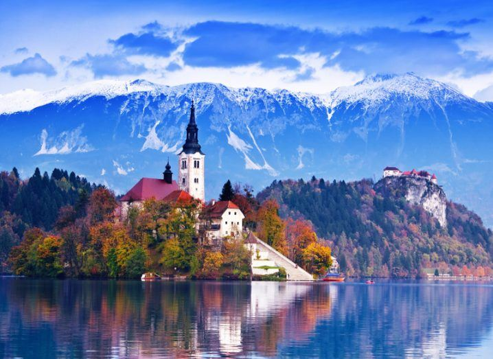 Picture of a beautiful church on an island in an alpine lake in Slovenia.