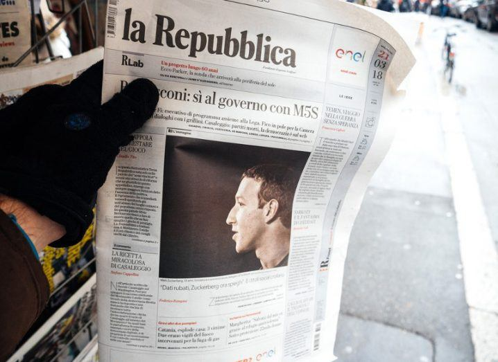 Man with gloves reading Italian newspaper La Repubblica at the height of the Cambridge Analytica scandal.