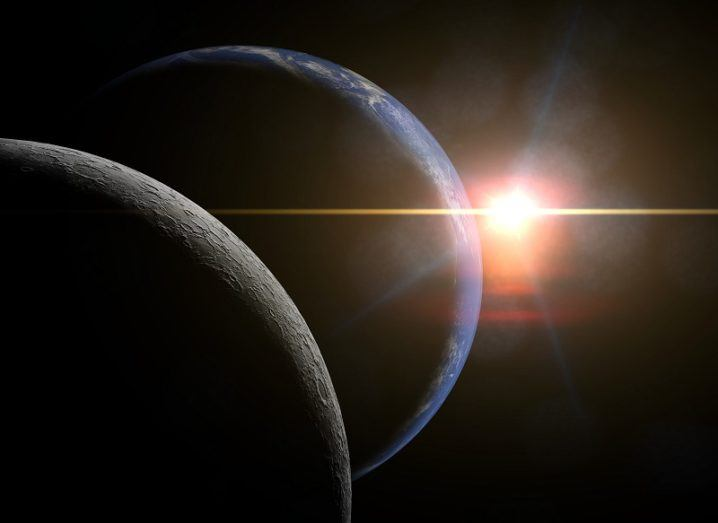 Concept shot of the far side of the moon, Earth and a distant sun.