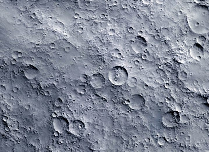 Close-up of the moon's grey surface dotted with craters.