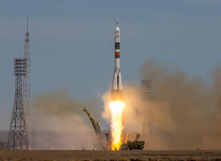 A Russian Soyuz rocket launching to space from the Baikonur launch pad.