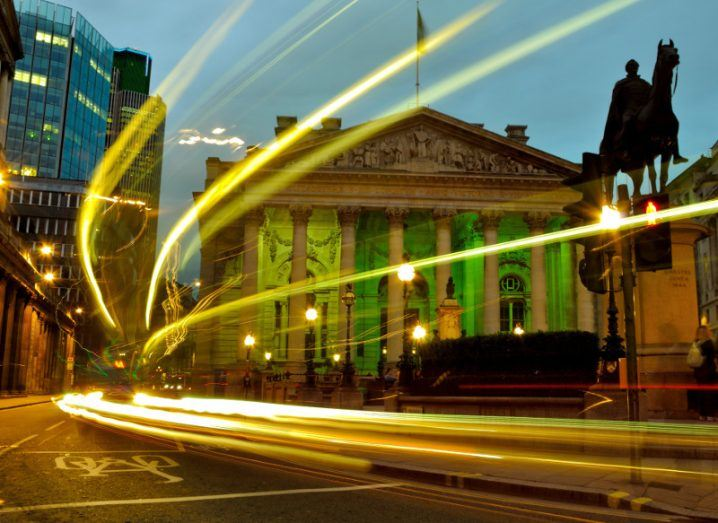 Picture of London's Royal Exchange with lights blurring past.