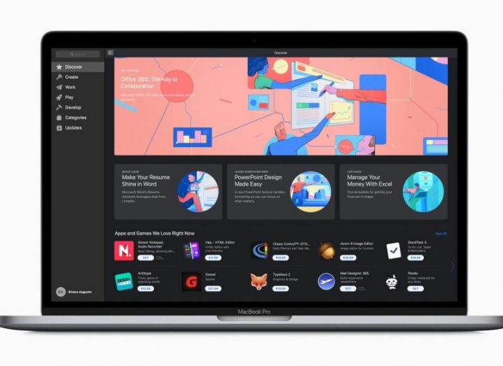 An Apple MacBook displaying the new App Store featuring Microsoft Office products and various icons.