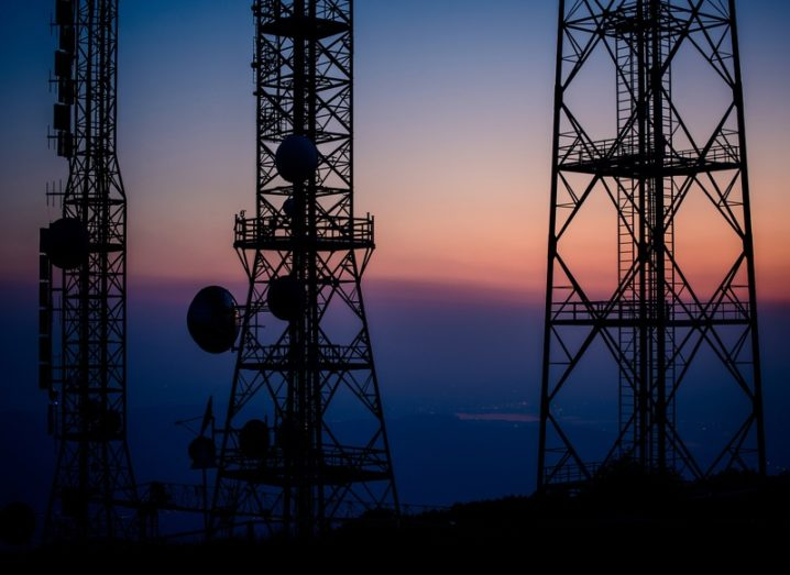 Radio repeater antennas on top of a mountain at sunset. 5G network concept.