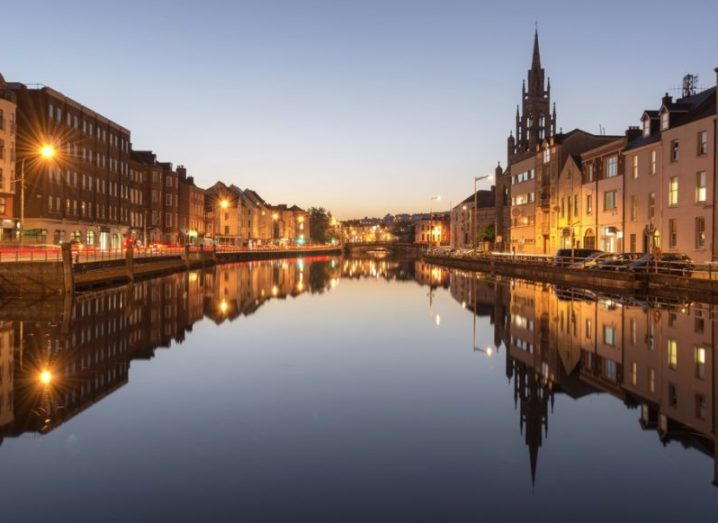 View of the River Lee in Cork City, with the buildings reflected in the still water.
