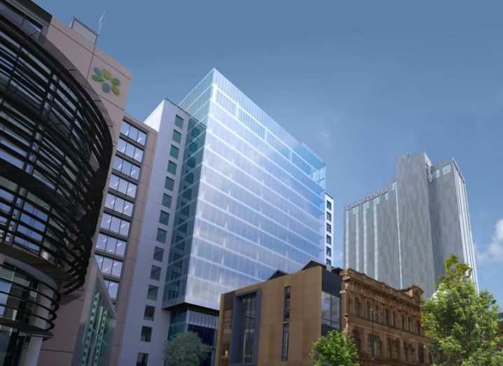 A CGI rendering of the new Deloitte office building, a modern glass tower set against a blue sky.