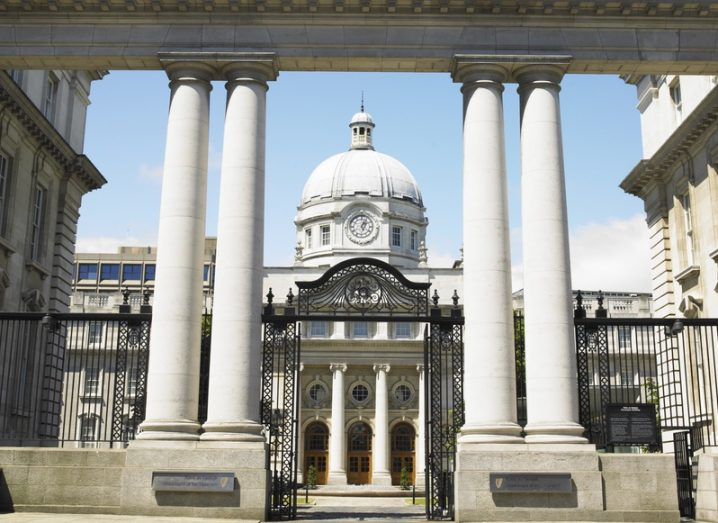 Leinster House, Dublin. A grand old granite building with columns and iron gates at front.