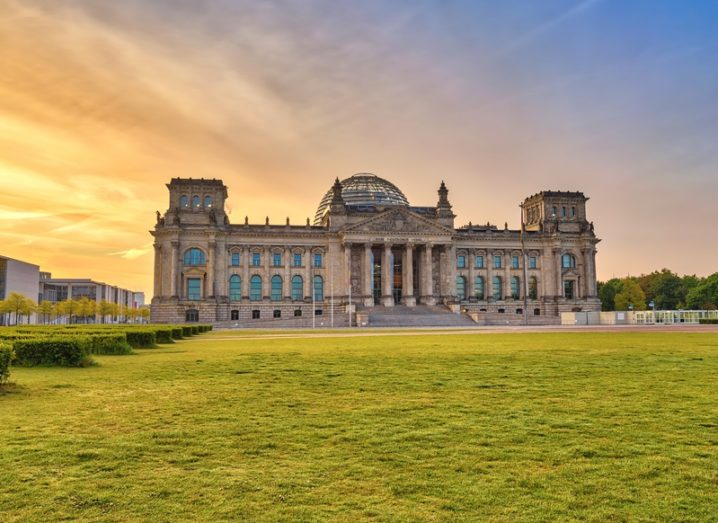 Berlin sunrise city skyline at Reichstag German parliament building.