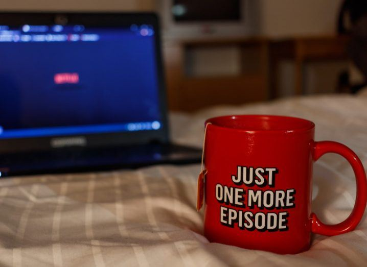 Watching Netflix series with a cup of tea that says just one more episode.
