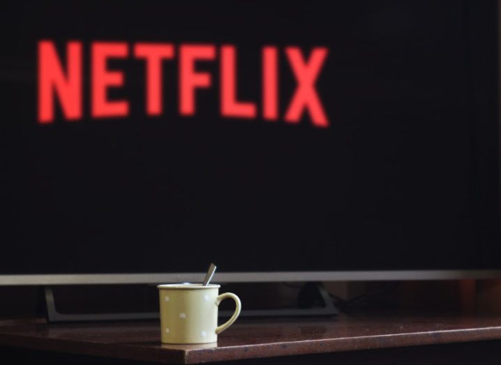 A warm drink in front of a TV screen with Netflix on display.