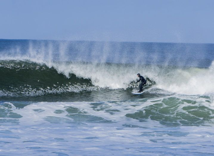 A surfer on the waves in the west of Ireland.