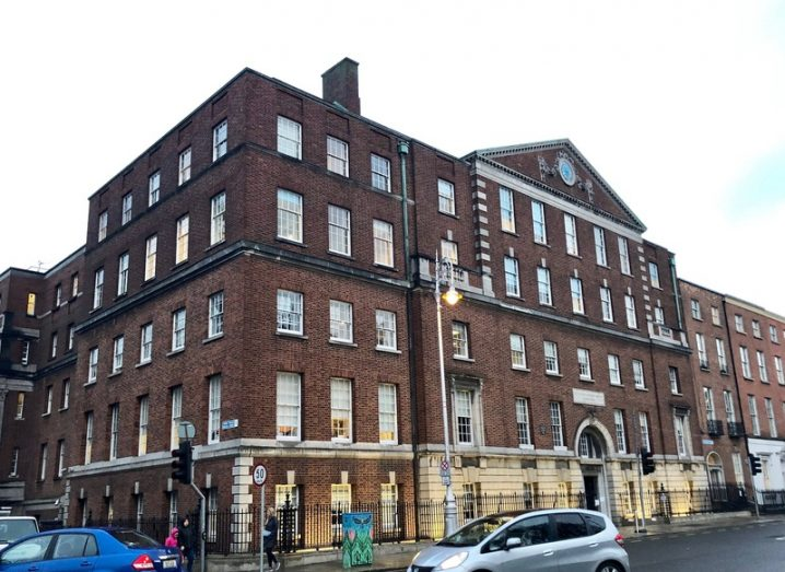 National Maternity Hospital on Holles Street, large brown building with cars driving by.