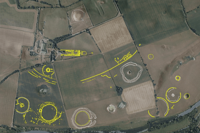 Birdseye shot of a fields with buried structures of various shapes shown as yellow and white outlines.